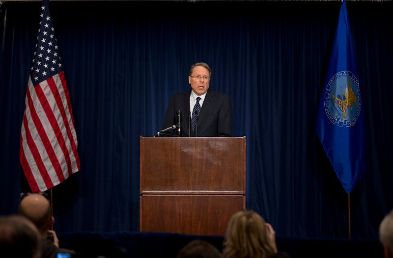 ". The National Rifle Association executive vice president Wayne LaPierre, speaks during a news conference in response to the Connecticut school shooting on Friday, Dec. 21, 2012 in Washington.  The nation\'s largest gun-rights lobby is calling for armed police officers to be posted in every American school to stop the next killer ""waiting in the wings.\""   (AP Photo/ Evan Vucci)"