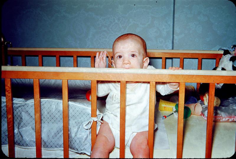baby richard teething on crib.jpg
