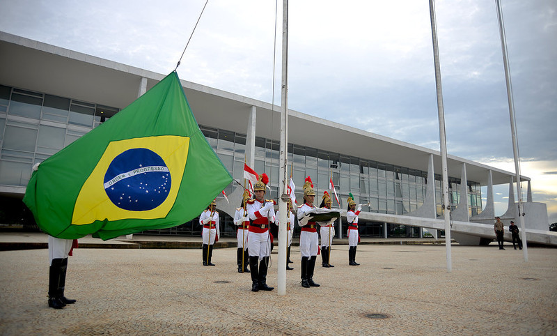 . Soldiers of the presidential guard prepare to raise the flag at half-mast at the Planalto Palace in Brasilia to honor the victims of a nightclub blaze in Santa Maria, Southern of Brazil on January 28, 2013. Brazilians on Monday were mourning the victims of a nightclub blaze in a small university town that left more than 230 people dead and over 100 injured, with many still fighting for their lives. PEDRO LADEIRA/AFP/Getty Images