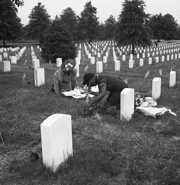 . Arlington Cemetery, Arlington, Virginia. Decorating a soldier\'s grave on Memorial Day, 1943. Esther Bubley, Photographer.  Courtesy the Library of Congress