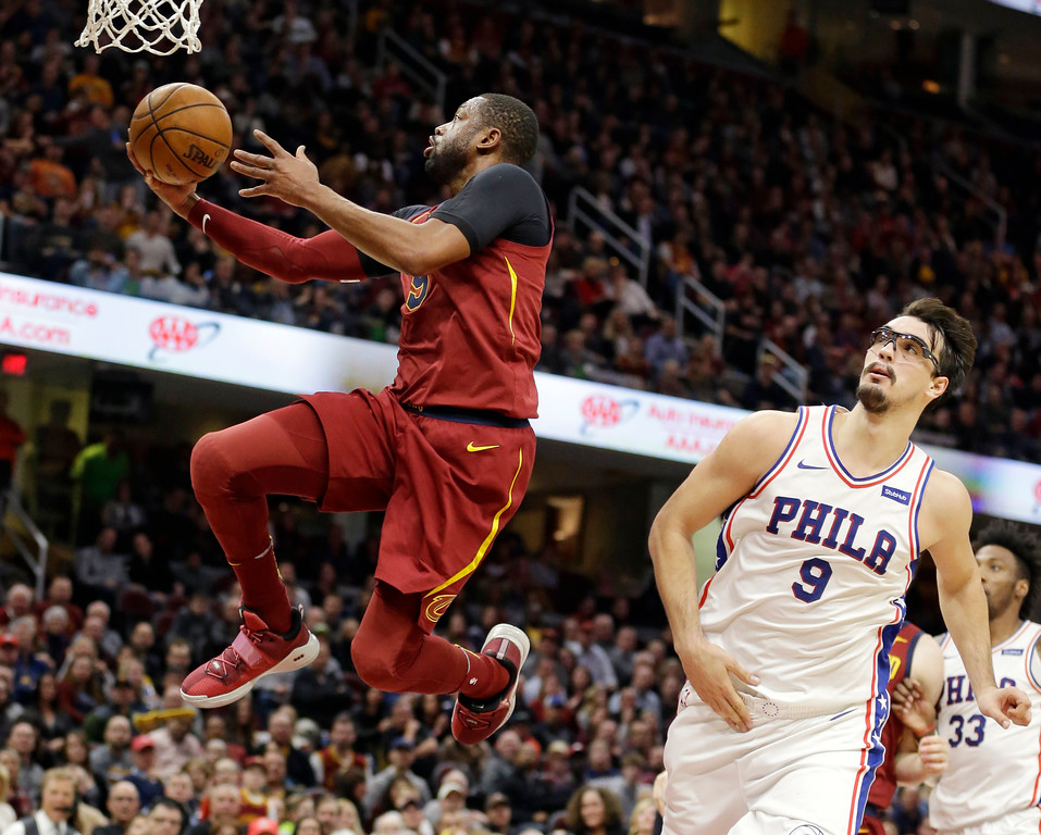 . Cleveland Cavaliers\' Dwyane Wade drives to the basket as Philadelphia 76ers\' Dario Saric, right, watches during the second half of an NBA basketball game, Saturday, Dec. 9, 2017, in Cleveland. The Cavaliers won 105-98. (AP Photo/Tony Dejak)