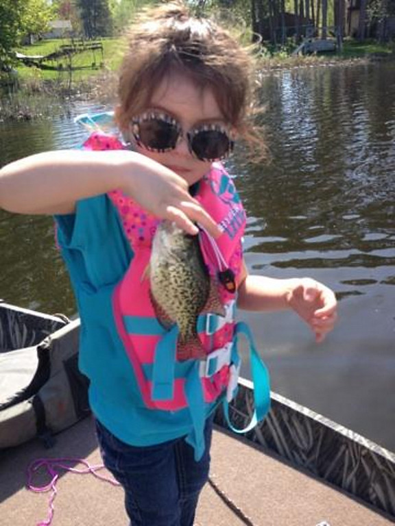 ". Gigi Soto Valento, 4, of South St. Paul, caught and released this crappie while fishing near Scandia with her dad Jose\' and grandpa Porky May 25.  It was her first time fishing. ""This is so fun!\"" she said. (Photo courtesy Lynne Scharffbillig)"