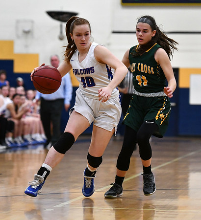 2/26/2020 Mike Orazzi | StaffrSt. Paul Catholic High School's Sophia Gerst r(10) and Holy Cross' Mya Zaccagnini (11) during Wednesday night's CCC girls basketball tournament at Kennedy High School in Waterbury. rr
