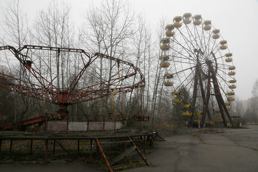 . A playground in the deserted town of Pripyat, Ukraine, some 3 kilometers (1.86 miles) from the Chernobyl nuclear plant  Ukraine, Tuesday, Nov. 27, 2012.  Workers on Tuesday raised the first section of a colossal arch-shaped structure that is eventually to cover the exploded reactor at the Chernobyl nuclear power station. Project officials on Tuesday hailed the raising as a significant step in a complex effort to liquidate the consequences of the world\'s worst nuclear accident, in 1986. (AP Photo/Efrem Lukatsky)