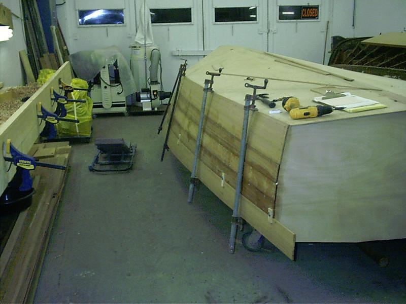 Fitting last plank on starboard side.