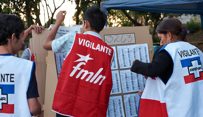 Election day in Santa Ana: <br /> Vigilantes (poll watchers) assigned to each voting table help mount the information voters will need to consult to ensure that they are in the correct precinct.