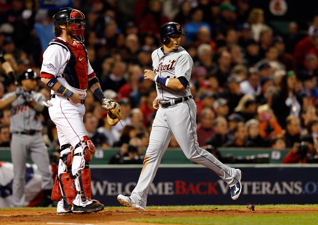 . Victor Martinez #41 of the Detroit Tigers scores in the second inning against the Boston Red Sox during Game Two of the American League Championship Series at Fenway Park on October 13, 2013 in Boston, Massachusetts.  (Photo by Jim Rogash/Getty Images)