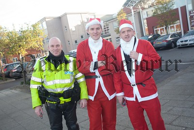 St Paul's Principal Jarlath Burns is pictured with Sgt Sam Hoey and Con Mark McGarrity. R1551019