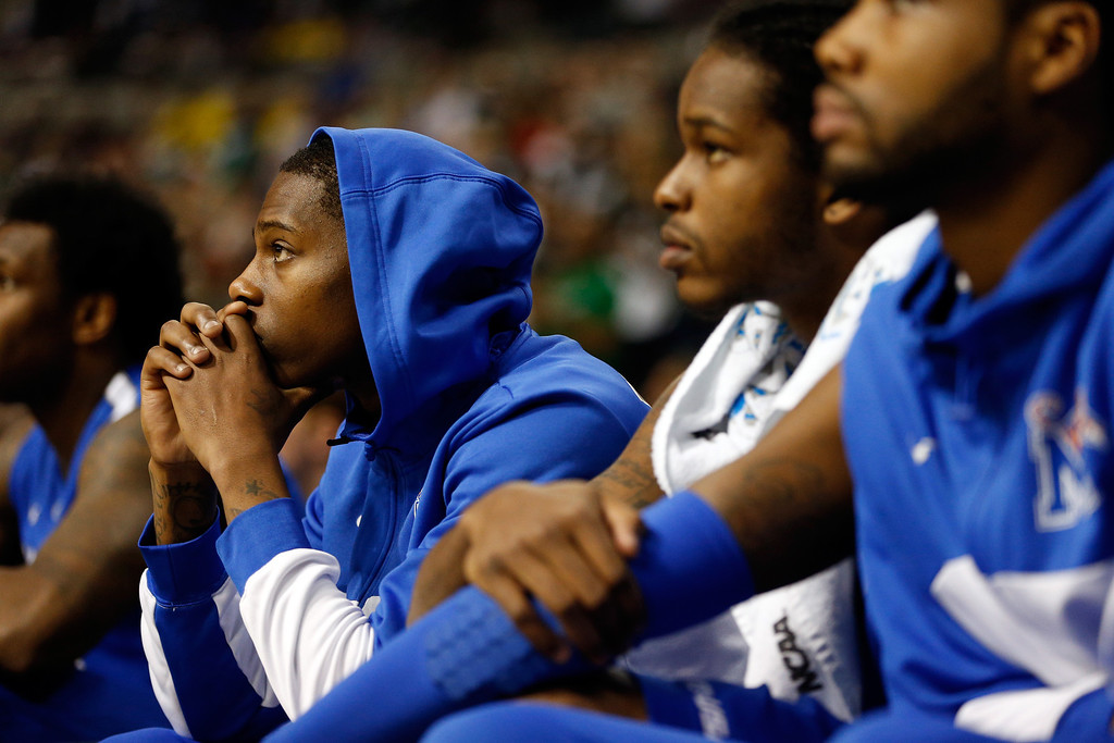 . AUBURN HILLS, MI - MARCH 23:  Players from the Memphis Tigers look on dejected from the bench in the second half against the Michigan State Spartans during the third round of the 2013 NCAA Men\'s Basketball Tournament at The Palace of Auburn Hills on March 23, 2013 in Auburn Hills, Michigan.  (Photo by Gregory Shamus/Getty Images)