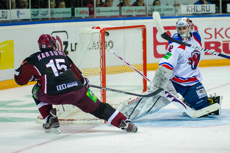 Martins Karsums (15) scores the goal during the second period of the KHL regular championship game between Dinamo Riga and Lev Praha in Arena Riga