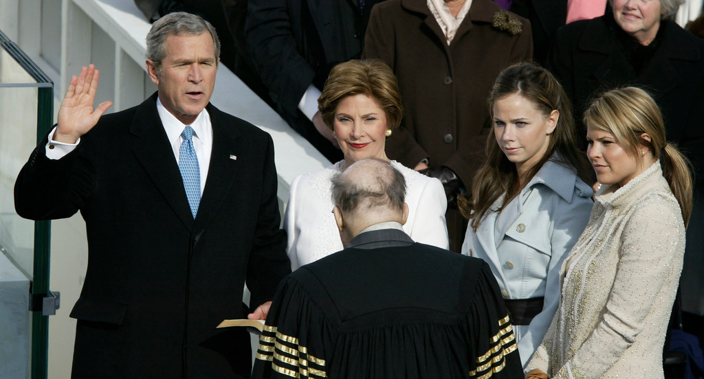 . President Bush is sworn in by Chief Justice William Rehnquist during his inauguration on Capitol Hill Thursday, Jan.20, 2005. First lady Laura Bush holds the bible as daughters, Jenna, right, and Barbara look on. (AP Photo/Stephan Savoia)