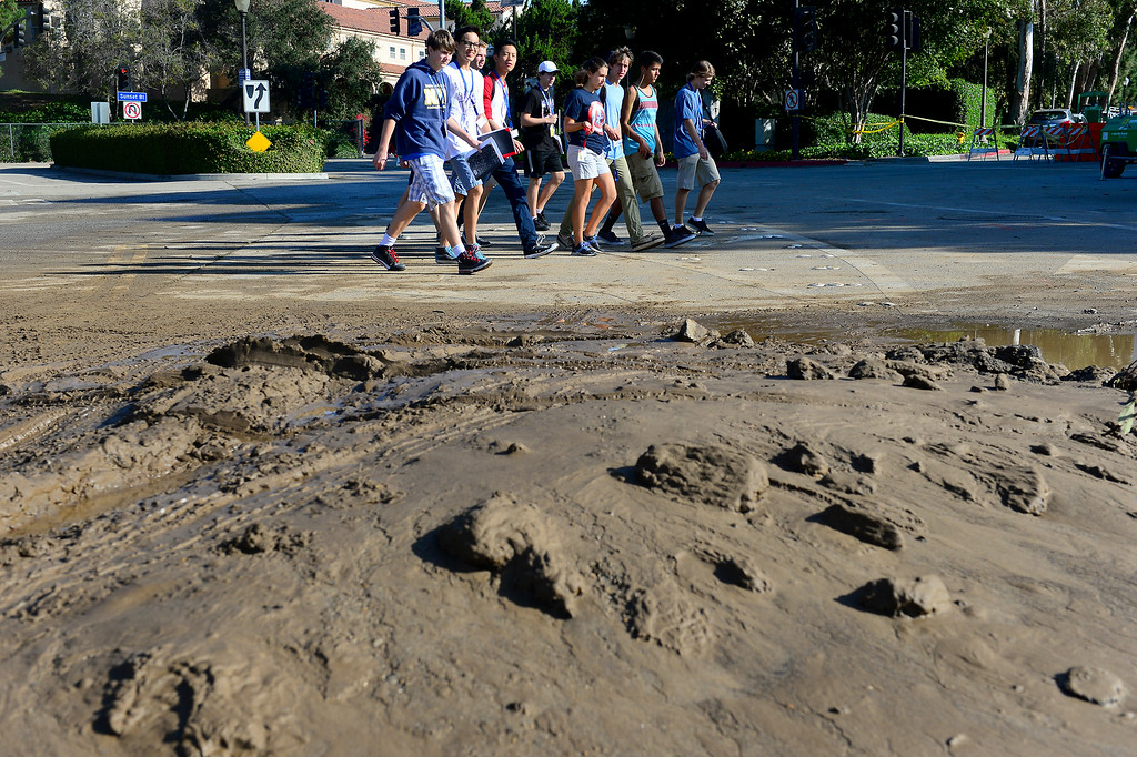 . Students walk past mud at UCLA, Wednesday, July 30, 2014. (Photo by Michael Owen Baker/Los Angeles Daily News)