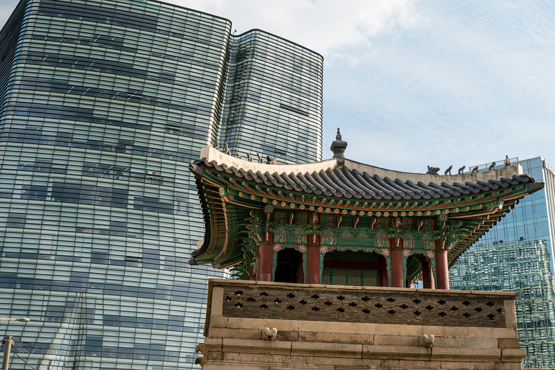 Traditional watchtower in front of skyscraper, Dongsibjagak Watchtower, Seoul, South Korea