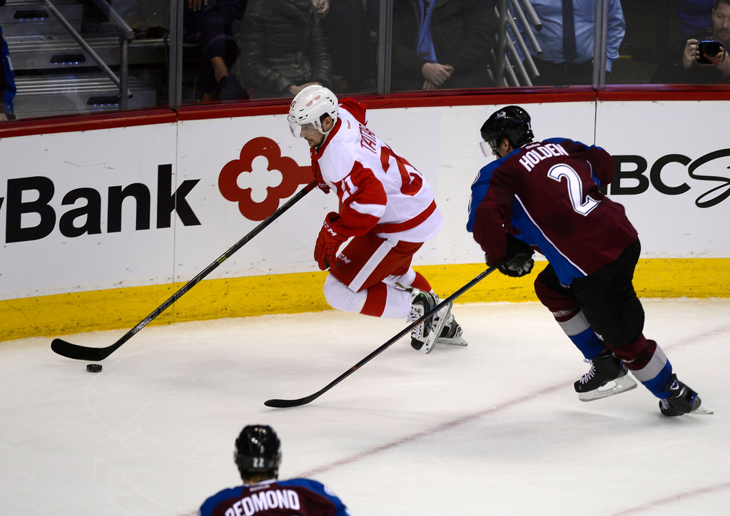 . DENVER, CO - February 5: Detroit Red Wings left wing Tomas Tatar (21) gets away from the defense of Colorado Avalanche defenseman Nick Holden (2) during the second period Thursday, February 5, 2015 at the Pepsi Center in Denver, Colorado. (Photo By Brent Lewis/The Denver Post)