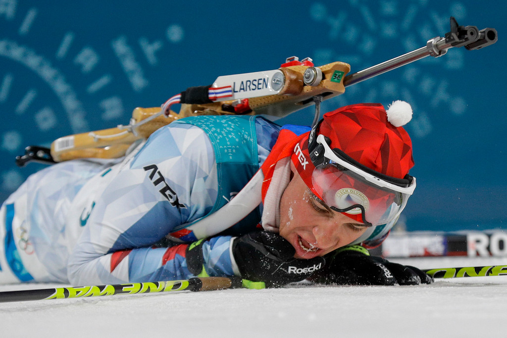 . Silver medalist Michal Krcmar, of the Czech Republic, collapses on the snow in the finish area after his race in the men\'s 10-kilometer biathlon sprint at the 2018 Winter Olympics in Pyeongchang, South Korea, Sunday, Feb. 11, 2018. (AP Photo/Gregorio Borgia)