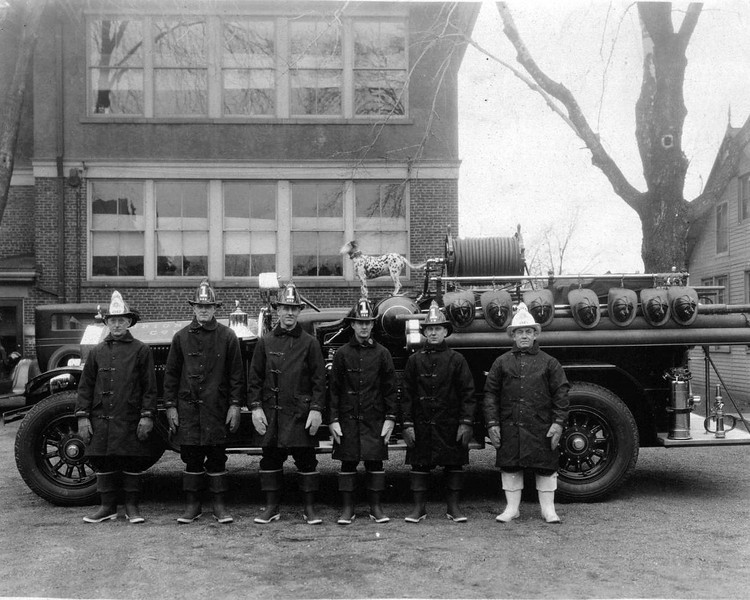 1929 Fire Dept. with fire dog.