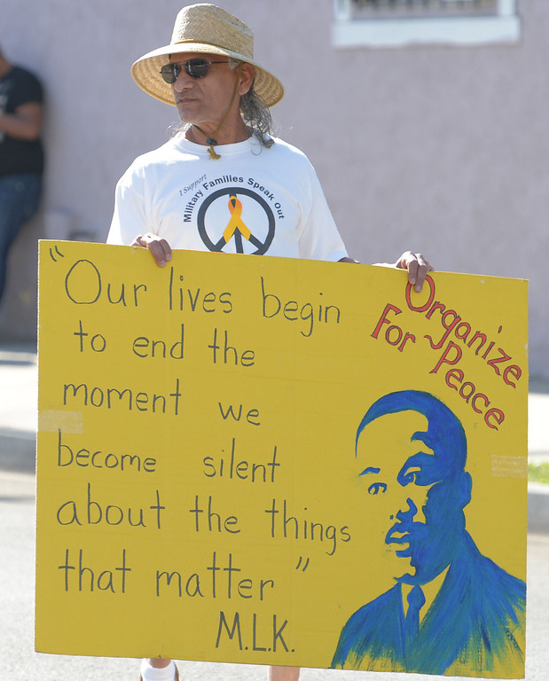 . The 26th Annual Martin Luther King, Jr., Peace & Unity Parade Saturday, January 18, 2014, Long Beach, CA.   The Long Beach Area Peace Network marches with banners featuring King, Jr., quotes. Photo by Steve McCrank/Daily Breeze