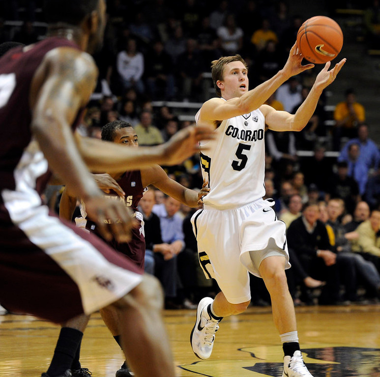 . University of Colorado\'s Eli Stalzer passes the ball during a game against Texas Southern on Tuesday, Nov. 27, at the Coors Event Center on the CU campus in Boulder.  Jeremy Papasso/ Camera