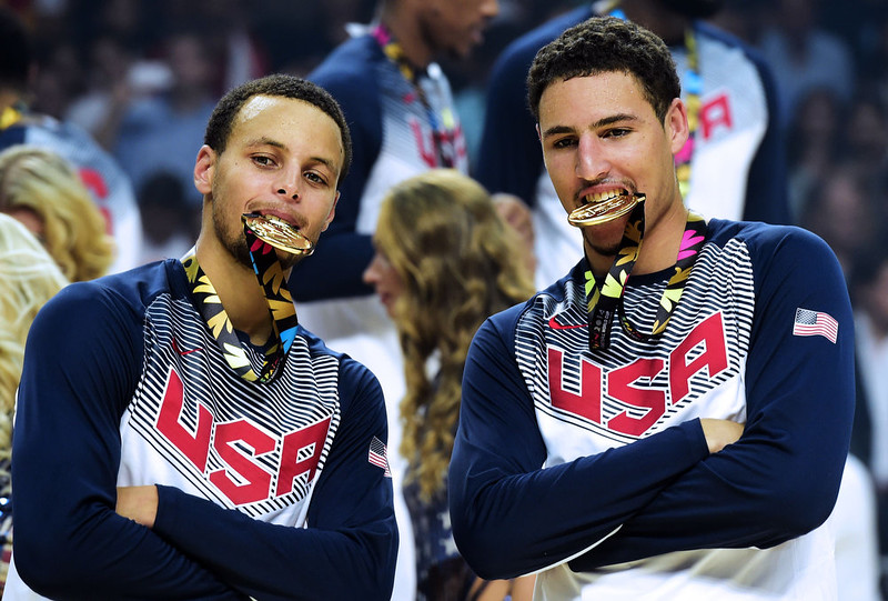 . US guard Stephen Curry (L) and US forward Rudy Gay bite their gold medals after winning the 2014 FIBA World basketball championships final match USA vs Serbia at the Palacio de los Deportes in Madrid on September 14, 2014. USA won 129-92.  JAVIER SORIANO/AFP/Getty Images