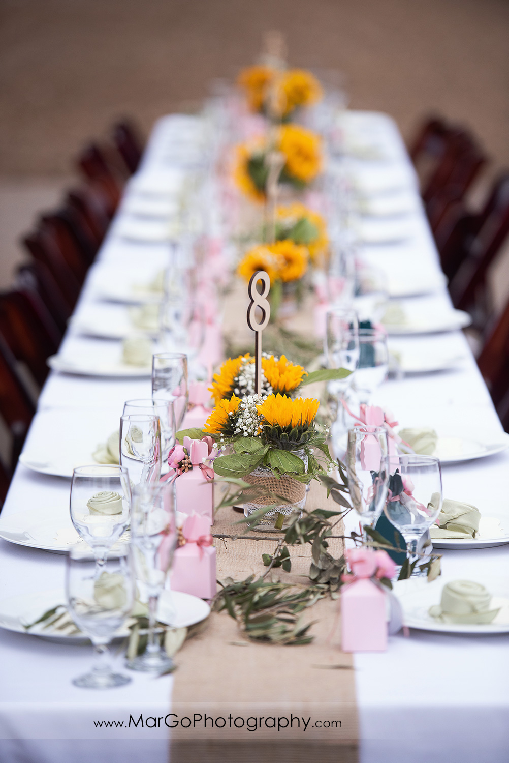 yellow flowers wedding table decor at Long Branch Saloon & Farms in Half Moon Bay