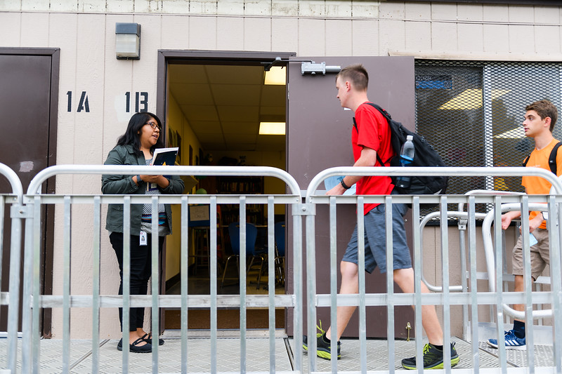 Student teacher Laura Cruz, left, helps students check-in to the newly-built portable classrooms. Back to school day at McNary High School on Wednesday, September 4, 2019 in Keizer, Ore.