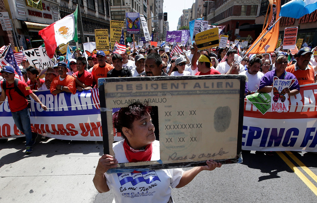. Rosa Araujo, center, leads a large crowd of protesters during a May Day rally in Los Angeles, Wednesday, May 1, 2013.  Demonstrators demanded an overhaul of immigration laws Wednesday in an annual, nationwide ritual that carried a special sense of urgency as Congress considers sweeping legislation that would bring many of the estimated 11 million people living in the U.S. illegally out of the shadows. (AP Photo/Jae C. Hong)