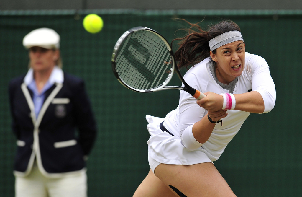 . France\'s Marion Bartoli returns against US player Sloane Stephens during their women\'s singles quarter-final match on day eight of the 2013 Wimbledon Championships tennis tournament at the All England Club in Wimbledon, southwest London, on July 2, 2013. GLYN KIRK/AFP/Getty Images