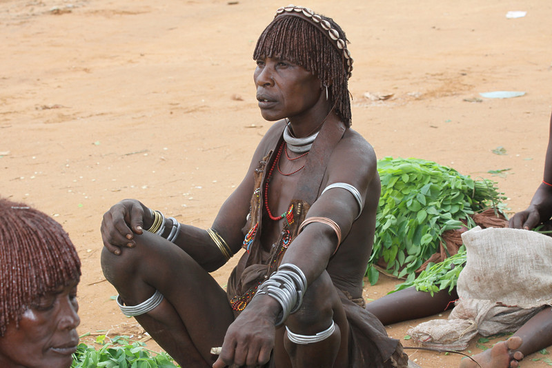 Hamer woman with iron coils on arm