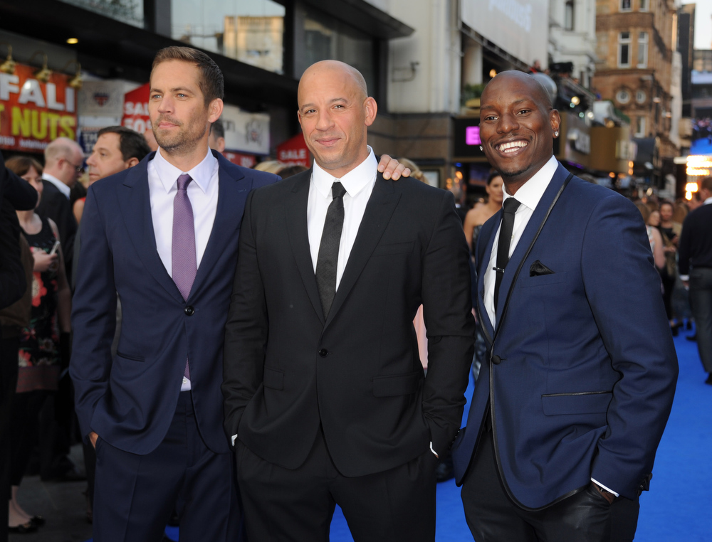 ". Actors Paul Walker, Vin Diesel and Tyrese Gibson attend the ""Fast & Furious 6\"" World Premiere at The Empire, Leicester Square on May 7, 2013 in London, England.  (Photo by Stuart C. Wilson/Getty Images for Universal Pictures)"