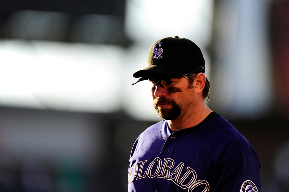. Colorado Rockies first baseman Todd Helton (17) reacts to a throwing error by starting pitcher Alex White (6) during the second game of a Memorial Day doubleheader at Coors Field on Monday, May 28, 2012. The Rockies won the first game 9-7. AAron Ontiveroz, The Denver Post