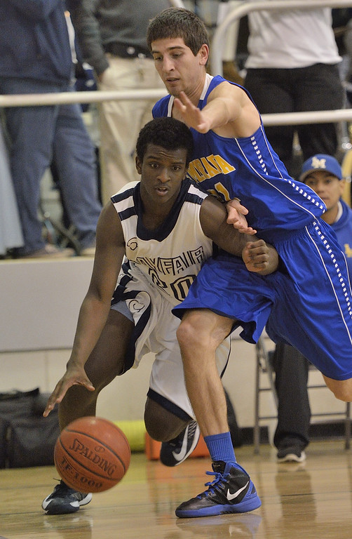 . LAKEWOOD, CALIF. USA -- Mayfair\'s Brandon Reynolds (20) tries to get past La Mirada\'s Charlie Reid (21) in Lakewood, Calif., on February 8, 2013. Mayfair defeated La Mirada 60 to 59. Photo by Jeff Gritchen / Los Angeles Newspaper Group