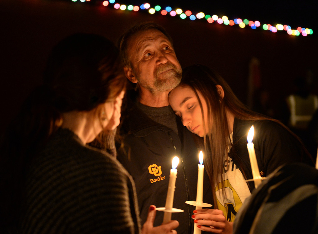 . CENTENNIAL, CO. - DECEMBER 20:  Mark Goncalves attended a candlelight vigil for Claire Davis with his daughters Angela, left, and Julia, right. Reverend Bradley Stoltenow led a candlelight vigil for Claire Davis at Shepherd of the Hills Lutheran Church December 20, 2013. Photo By Karl Gehring/The Denver Post
