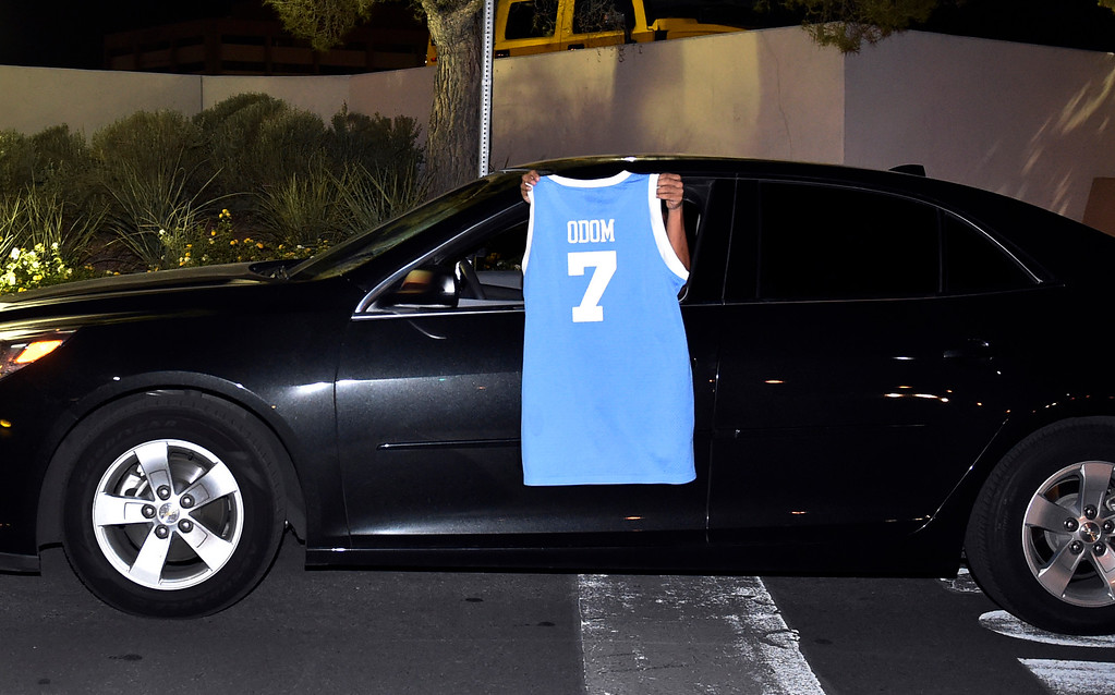 . A driver displays a basketball jersey with Lamar Odom\'s name as the driver exits Sunrise Hospital and Medical Center on Tuesday, Oct. 13, 2015, in Las Vegas. The former NBA basketball player was hospitalized after he was found unconscious Tuesday at a Nevada brothel, authorities said. (AP Photo/David Becker)