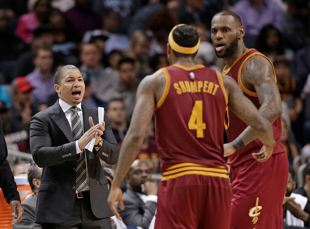 . Cleveland Cavaliers coach Tyronn Lue, left, talks with LeBron James, right, and Iman Shumpert, center, during the second half of an NBA basketball game against the Charlotte Hornets in Charlotte, N.C., Friday, March 24, 2017. The Cavaliers won 112-105. (AP Photo/Chuck Burton)