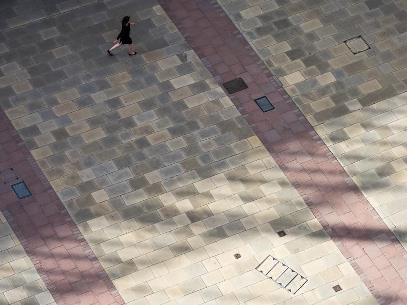 Woman walking through city square