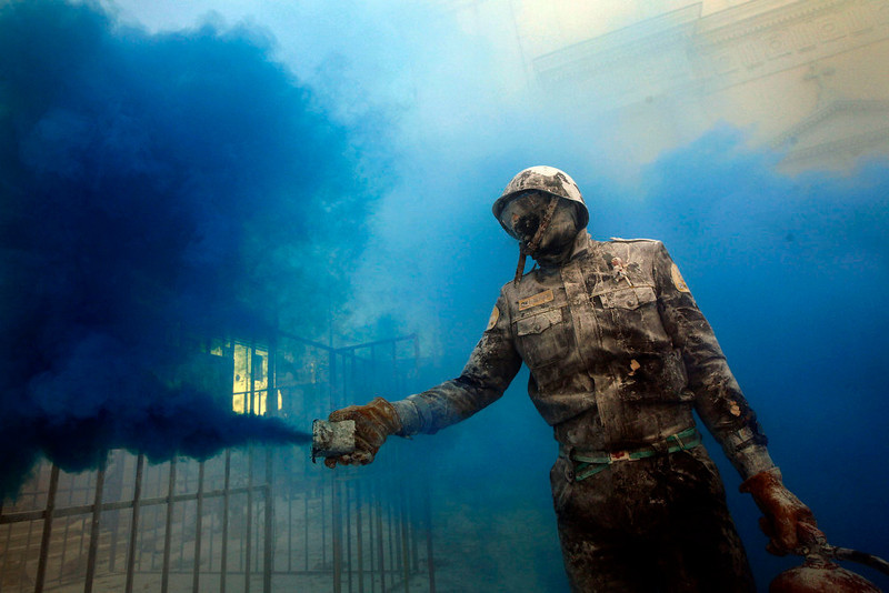 . A reveler takes part in festival of Els Enfarinats, in the town of Ibi near Alicante, Spain, Friday, Dec. 28, 2012. For 200 years the inhabitants of Ibi annually celebrate with a battle using flour, eggs and firecrackers, outside the city town hall. (AP Photo/Alberto Saiz)