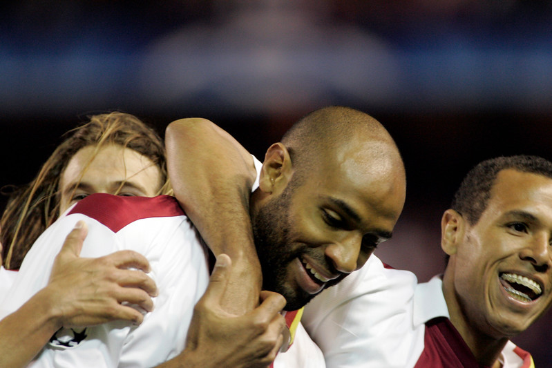 Frédéric Kanouté (center), Diego Capel (behind) and Luis Fabiano (right) celebrating a goal.UEFA Champions League first knockout round game (second leg) between Sevilla FC (Seville, Spain) and Fenerbahce (Istambul, Turkey), Sanchez Pizjuan stadium, Seville, Spain, 04 March 2008.