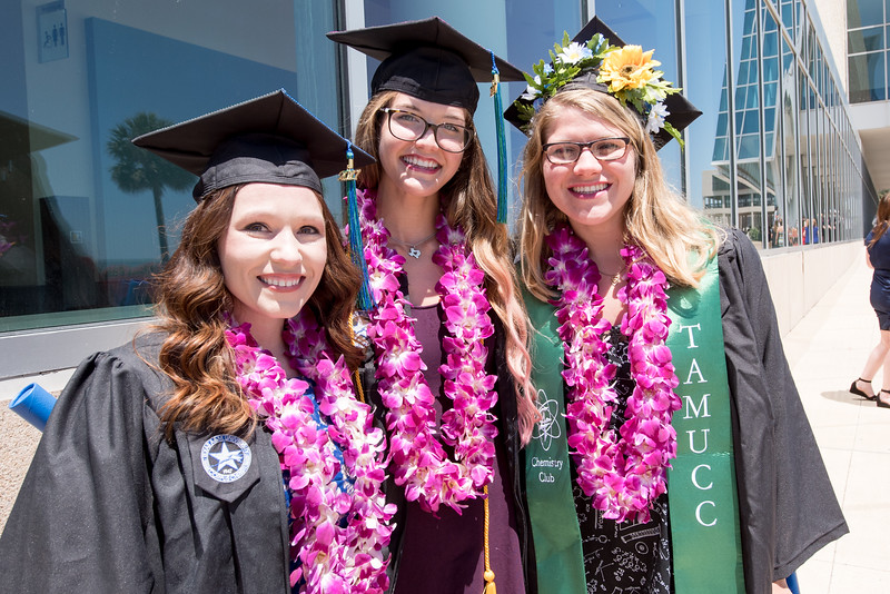 Amber Maynard (left), Valarie May, and Rebecca Rygowski. Over 1,100 graduates received their degrees during two commencement ceremonies held on May 13.