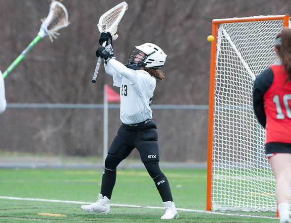 04/17/18 Wesley Bunnell | Staff Newington girls lacrosse was defeated 19-2 by Conard at Newington on Tuesday afternoon. Kali Lessard (23).