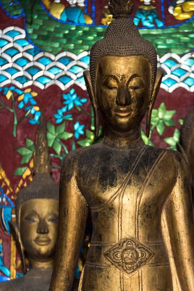 Statues in temple, Wat Xieng Thong temple, Luang Prabang, Laos
