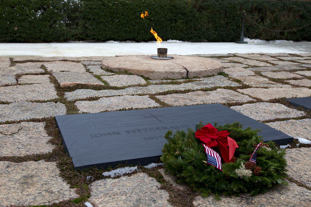 . A holiday wreath lays at the grave of President John F. Kennedy in Arlington National Cemetery in Arlington, Va., Saturday Dec. 14, 2013, during Wreaths Across America Day. Wreaths Across America was started in 1992 at Arlington National Cemetery by Maine businessman Morrill Worcester and has expanded to hundreds of veterans\' cemeteries and other locations in all 50 states and beyond. (AP Photo/Jose Luis Magana)