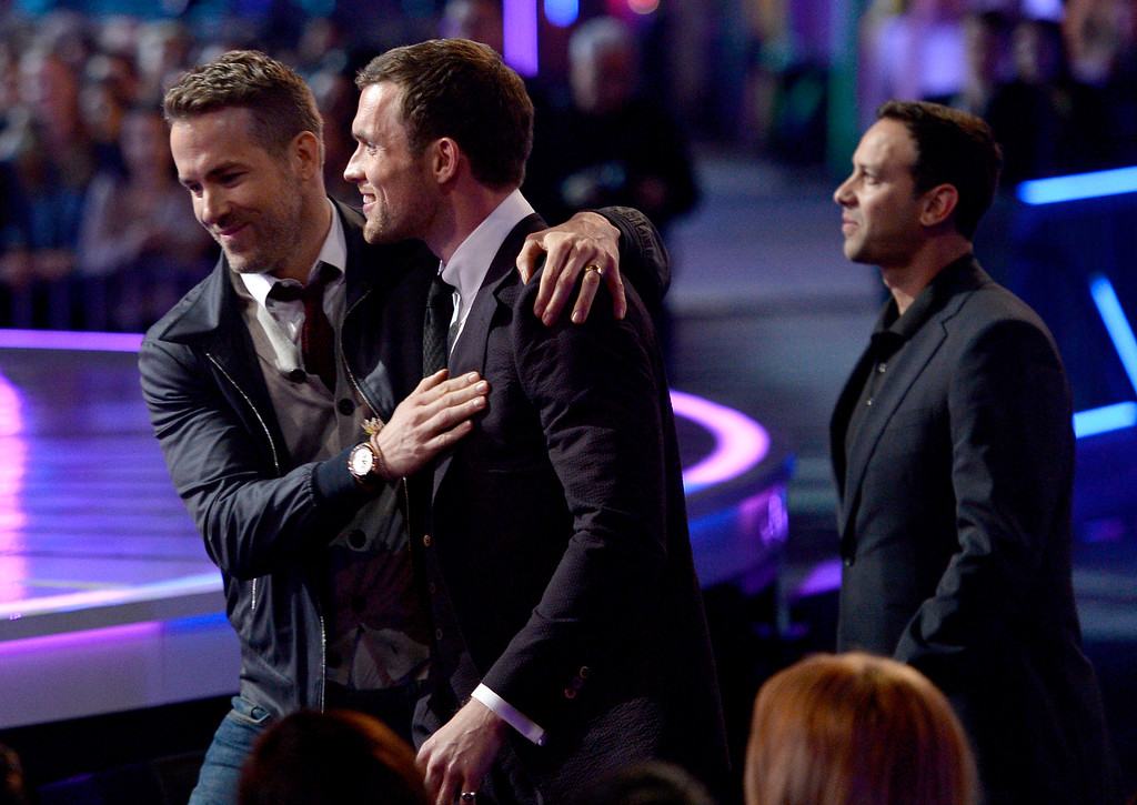 . Ryan Reynolds, from left, Ed Skrein and  Philip J. Silvera walk to the stage to accept the award for best fight at the MTV Movie Awards at Warner Bros. Studio on Saturday, April 9, 2016, in Burbank, Calif. (Kevork Djansezian/Pool Photo via AP)