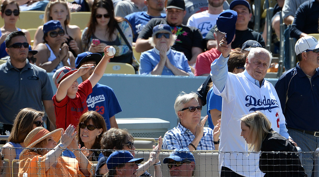 . Former Los Angeles Dodgers manager Tommy Lasorda tips his cap to the crowd during a Major league baseball game against the San Francisco Giants on Saturday, May 10, 2013 in Los Angeles.   (Keith Birmingham/Pasadena Star-News)