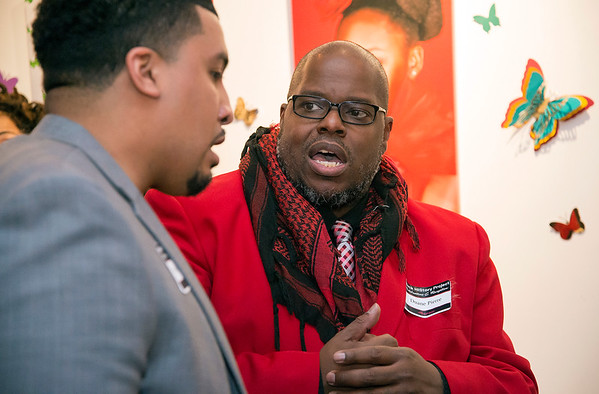 02/28/20 Wesley Bunnell | StaffrrTwenty five men were honored at Gallery 66 on Friday night for their involvement in the community as part of Black History Month. Honoree Manny Sanchez, L, ,speaks with fellow nominee Duane Pierre