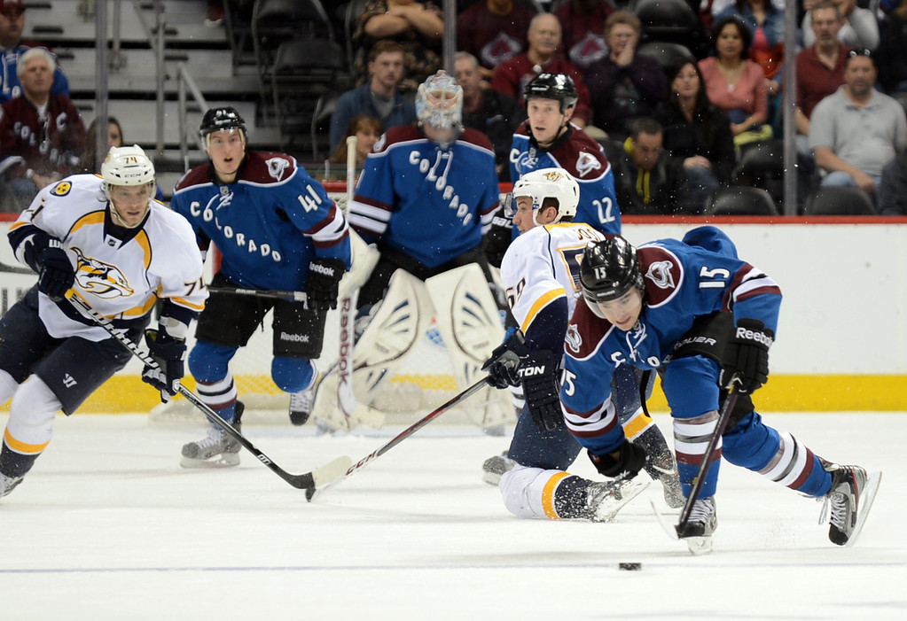 . PA Parenteau of Colorado Avalanche (#15), front, steals the puck from Roman Josi of Nashville Predators (#59) in the 1st period of the game at Pepsi Center. Denver, Colorado. March 30, 2013. (Photo By Hyoung Chang/The Denver Post)