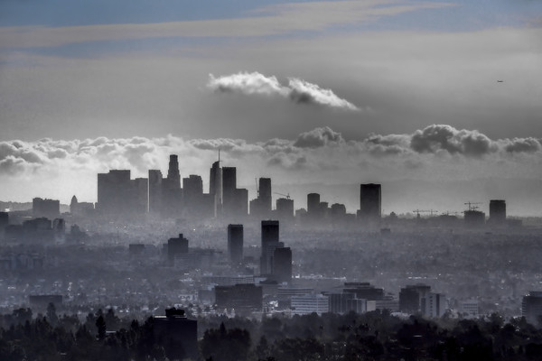 February 22 - A skyline, the sky some clouds, construction projects and an airplane in Los Angeles.jpg