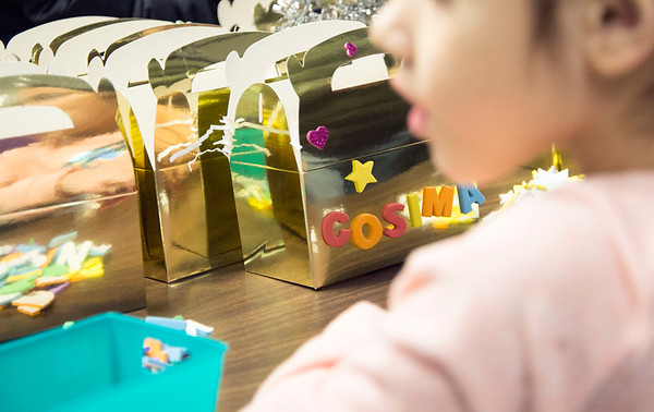 01/06/19 Wesley Bunnell | StaffrrThree Kings Day was celebrated at Neighborhood Services of New Britain at 223 Broad St for families on Monday night. Cosima Walas, age 6, decorates her gift basket with her name.