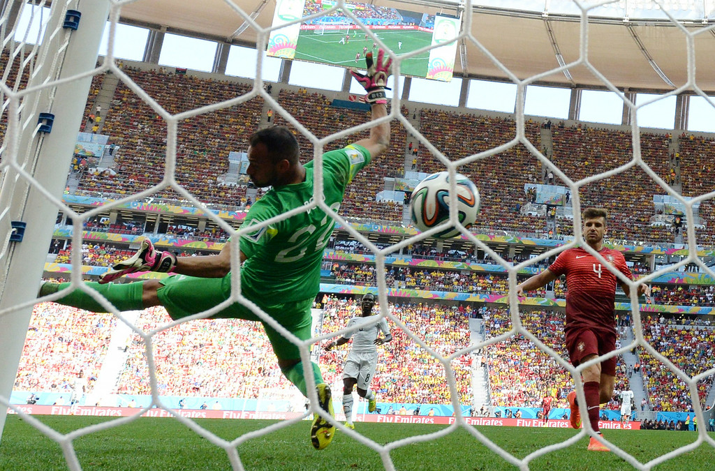 . Portugal\'s goalkeeper Beto (L) fails to save the ball during the Group G football match between Portugal and Ghana at the Mane Garrincha National Stadium in Brasilia during the 2014 FIFA World Cup on June 26, 2014. CARL DE SOUZA/AFP/Getty Images