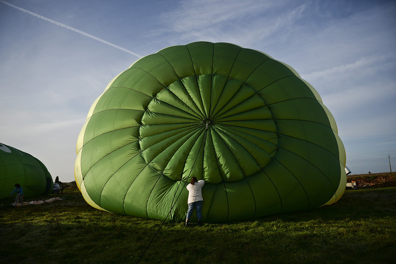 . A hot air balloon enthusiast prepares a balloon during the 18th International Festival of Hot Air Balloons in Alter do Chao in the center of Portugal on November 10 2014. PATRICIA DE MELO MOREIRA/AFP/Getty Images