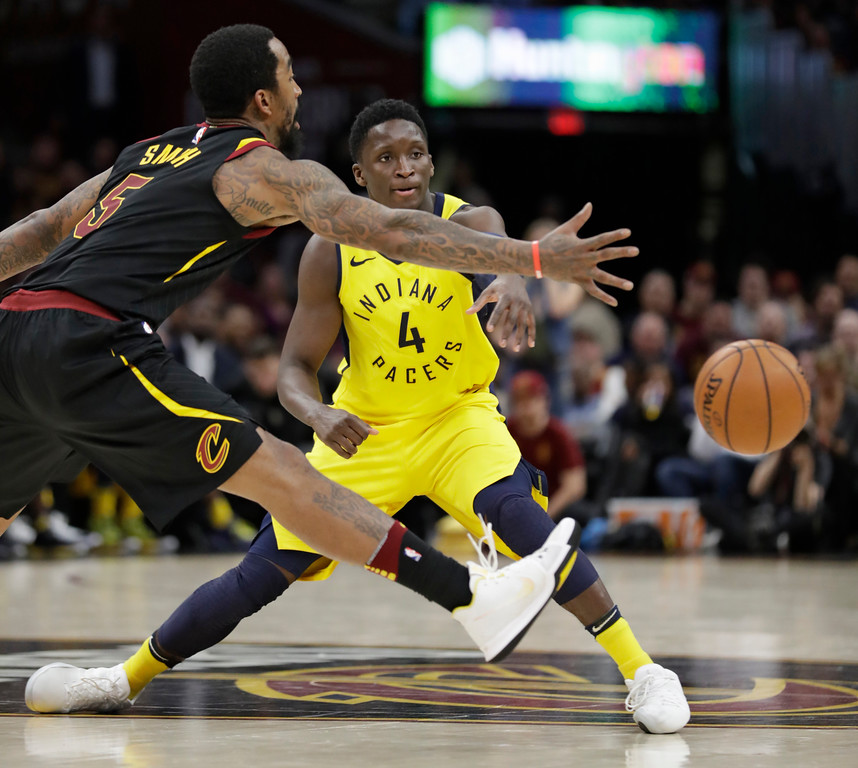. Indiana Pacers\' Victor Oladipo (4) passes against Cleveland Cavaliers\' JR Smith (5) in the second half of Game 5 of an NBA basketball first-round playoff series, Wednesday, April 25, 2018, in Cleveland. (AP Photo/Tony Dejak)
